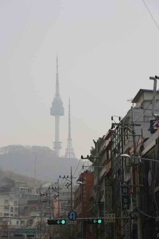 View of the Namsan Tower through the smog-filled sky.