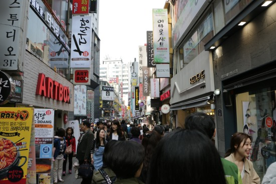 Walking through the crowded streets of Myeongdong