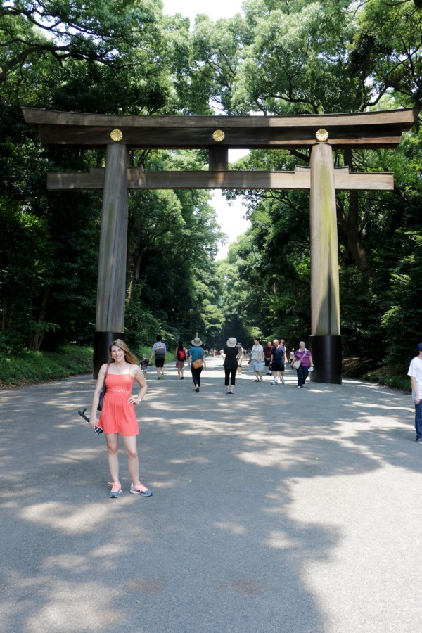 Standing outside the torii gate which separates the busy city life to the tranquil park/forest in which the shrine is located
