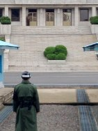 """In Front of Them All."" A ROK Soldier looking directly upon a KPA (North Korean) Soldier."
